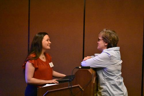 Erin Jackson speaking with an attendee of a recent talk in St. Louis, Missouri