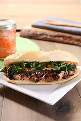 BANH MI: Fresh baked baguette with housemade pickled carrot & daikon, sliced cucumber, and cilantro. Served with Bragg's & our housemade sriracha mayonnaise.