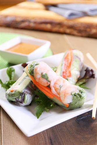 SUMMER ROLLS: Gluten-free rice paper wraps filled to the brim with spring mix, carrot, cucumber, red bell pepper, fresh mint &  basil, and chilled vermicelli noodles. Served with our housemade peanut sauce. Gluten free!