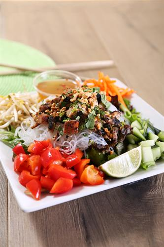 VERMICELLI NOODLE SALAD: Fresh spring mix and chilled vermicelli noodles, chopped cucumber, carrot, red bell pepper, bean sprouts, fresh cilantro & mint, and crushed peanuts. Served with our housemade Vietnamese or Vegan vinaigrette. Gluten free!