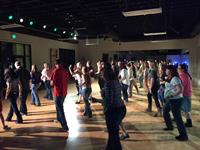 Teaching Line dancing at a corporate team building event