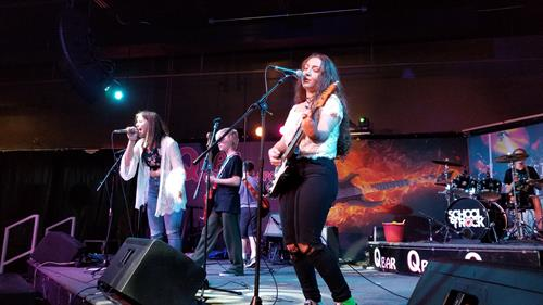 School of Rock Glen Ellyn students performing at Q-Bar Glendale Heights