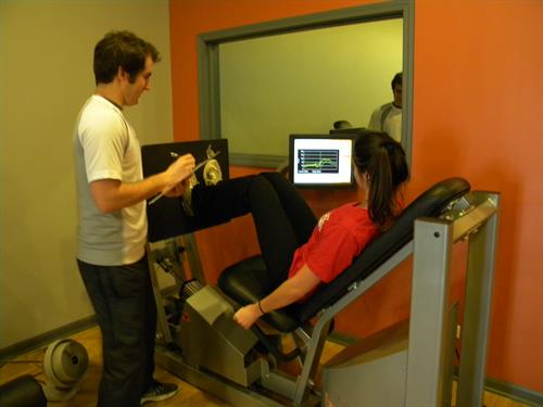 Client on the computerized leg press