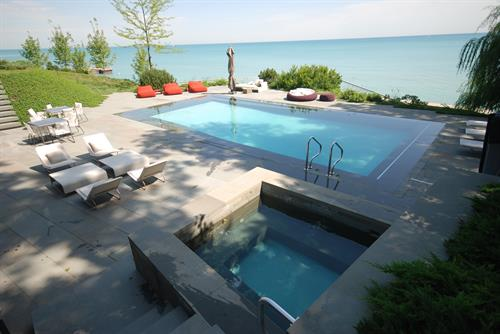 Award winning beach entry, auto pool cover.