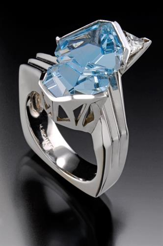 Aquamarine ring in Platinum with triangular diamond