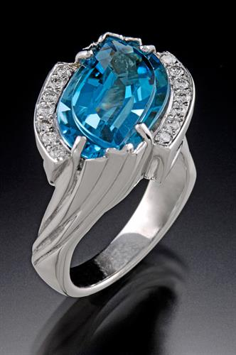 Uniquely cut Blue Topaz ring with diamonds in 14K white gold