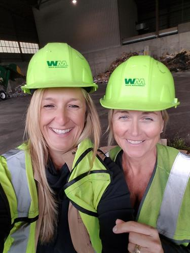 Kristen and Kelly Recycling at WM (No hat is too big:))