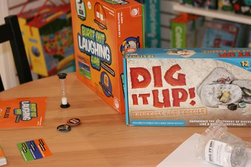 We always have games and toys out for you to try! Something you're curious about that's not out...just ask! We have demos of all our games!