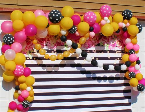 Organic style photo booth back drop using pink, black and gold.