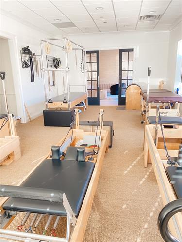 Pilates Room with Reformers, Cadillac and Chairs and Barrel