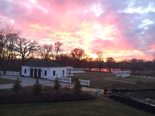 Sunset over the Garden Lodge and pond