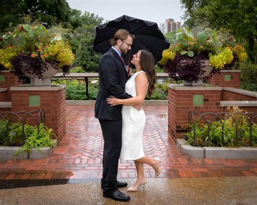 engaged couple in the rain