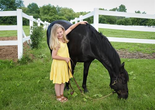 young girl with her horse