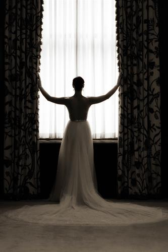 beautiful bride in window