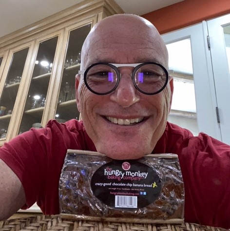 Howie Mandel holding his beloved Hungry Monkey Chocolate Chip Banana Bread