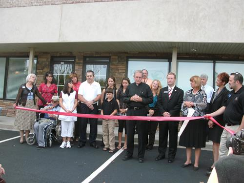 Deacon Bill blesses our office at our Ribbon Cutting.