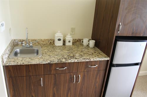 Apartment Kitchenette with granite counter-tops