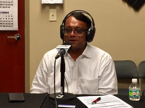 "Neel Majumdar presenting as a guest at the ""Open for Business"" show from BusinessRadioX"
