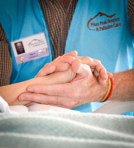 Volunteers at Pikes Peak Hospice offer patients the gift of time, a presence in the room a friend to talk to and a hand to hold.
