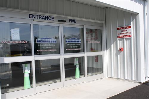 Wide sliding glass door entrances into climate control storage unit area
