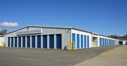 Clean, well-lit storage facility with security cameras
