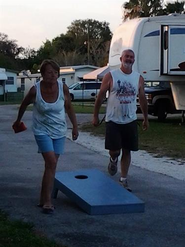 Playing Cornhole after our monthly get together!