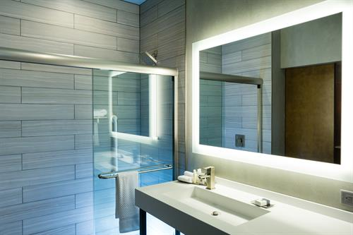 All of our guest restrooms feature a stylish makeup mirror and spacious layout