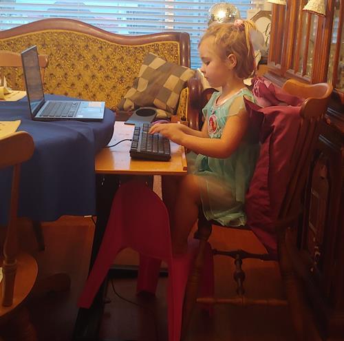 Kids ergonomics, external keyboard and mouse on laptop tray