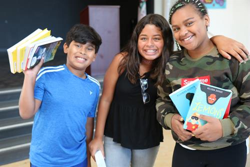 Promoting literacy: Happy students with new books purchased with grant support.