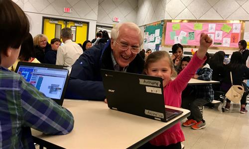 Fun with Coding: Families and students enjoy solving problems together.