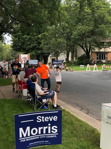"Near the parade finish, literally ""running for city council"" I never get tired of a hearty HELLO"