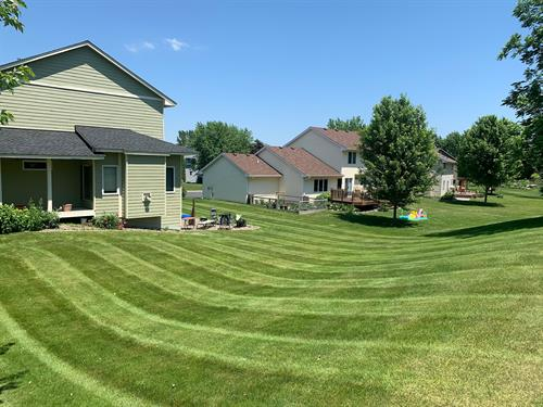 Beautiful stripes laid by our dedicated lawn maintenace crew.