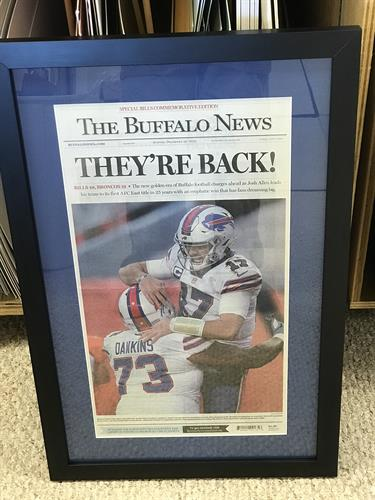 Decorate your man cave with a newspaper article featuring your favorite sport.