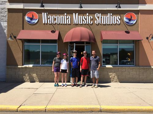 Mr. Brose and some students outside of Waconia Music Studios