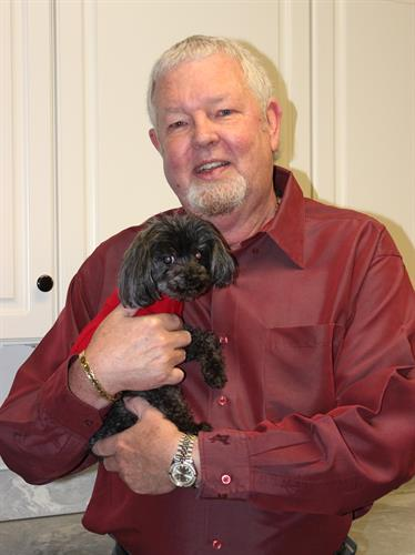 Dr. William Dubois with Teetee the therapy dog.