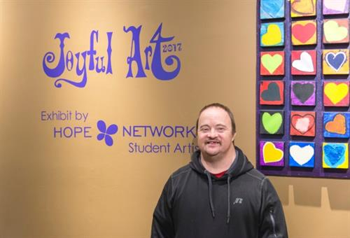 One of the student artists during the Joyful Arts Exhibit Reception for Hope Network!