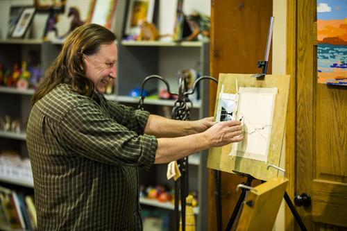 Artist Tom Tomasek doing a demonstration for visitors.