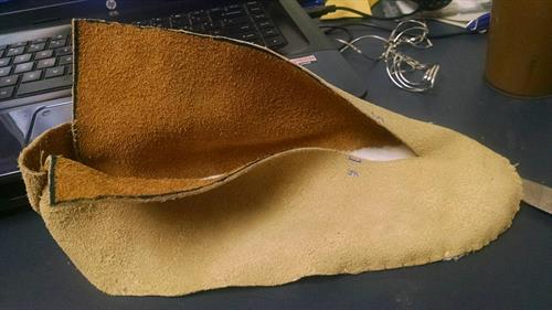 Here I am custom making this pair of Moccasins for a customer. Time consuming to put this together.