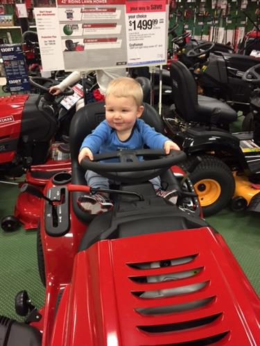 andrew driving tractor