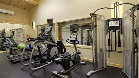 Check out our new fitness room overlooking the pool area.