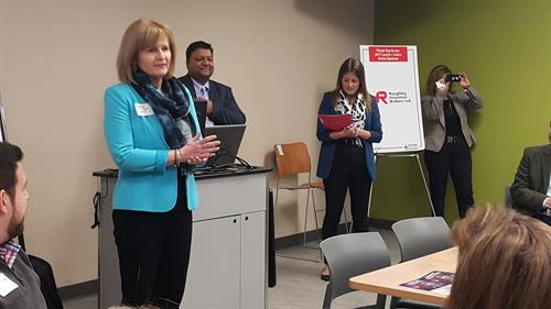 An action shot of our Executive Director, Chrystine Langille, addressing members and non-members at a Lunch + Learn at Centennial Learning Site in Pickering.