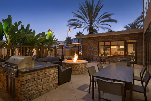 Relax by the Outdoor Fireplace in our Patio