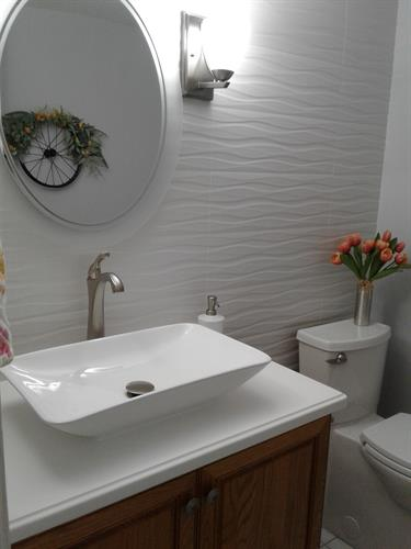 Updated bathroom, Wave tile wall, new Corian top with rectangle vessel bowl