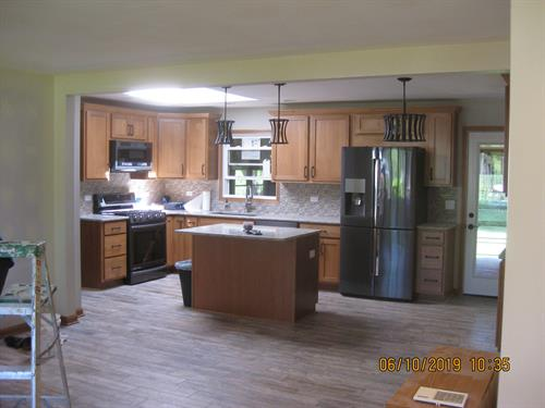 Brand new kitchen, walls removed, porcelain tile throughout,