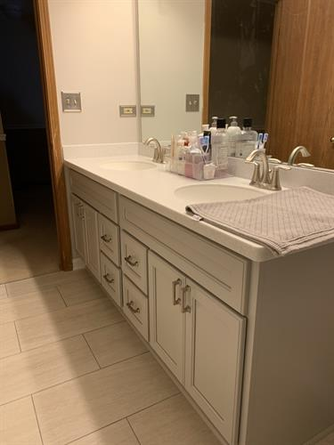 Bathroom remodel, tub out shower in with tile, and glass accent. new porcelain floors, Bertch vanity , Corian countertops