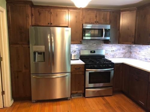 New kitchen cabinets, quartz countertops, and backsplash
