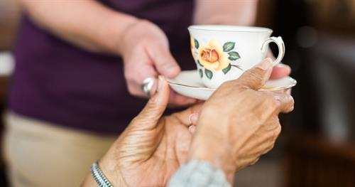 Gallery Image CAREGiver_giving_senior_coffee_11.jpg