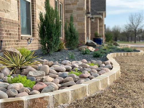 Flower Bed Installation with Stone Borders and Hardscape Accents