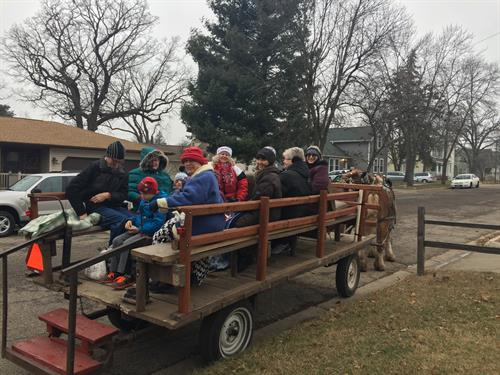 Multi-generation activities! Caroling by horse-drawn wagon