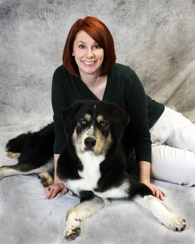 Susan Miller, Practice Manager, with her dog Ledger